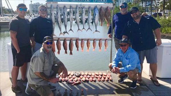 6 men fishing at lake