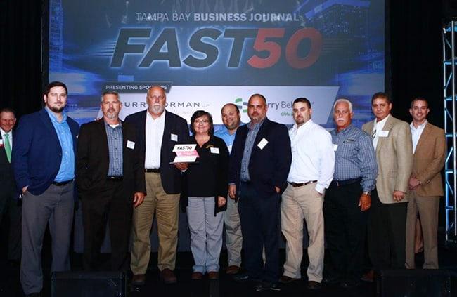 fast50-autodevgroup men receiving award