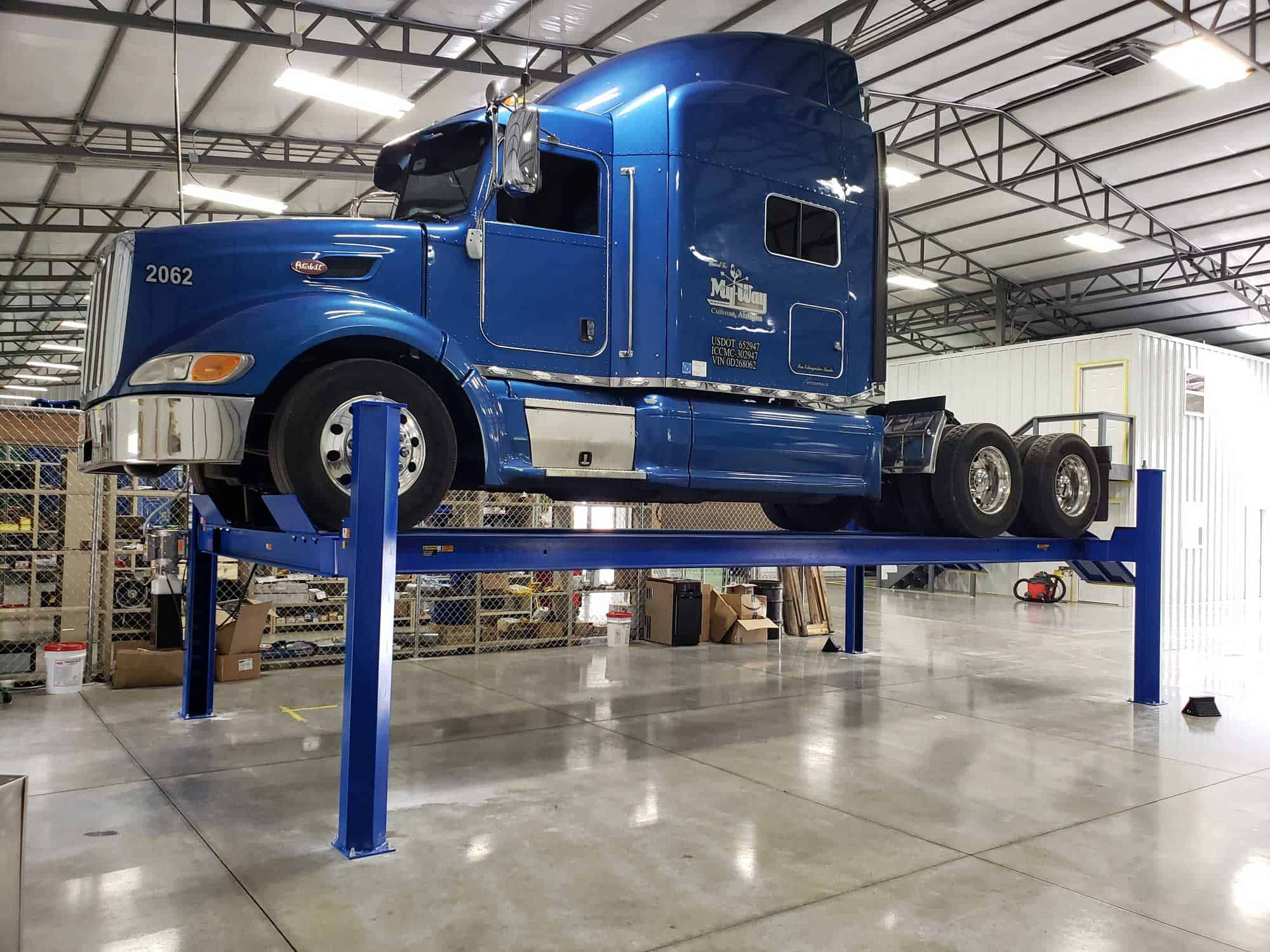 blue-semi-on-heavy-duty-lift